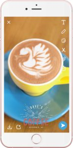 example of a geofilter over a picture of latte art